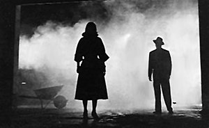 Film noir - Two silhouetted figures in The Big Combo (1955). The film's cinematographer was John Alton, the creator of many of film noir's stylized images.