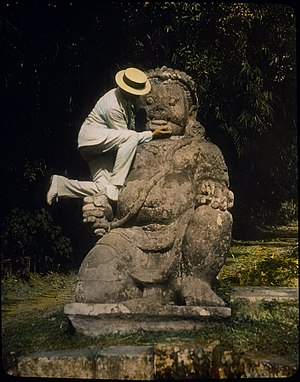 Magelang Regency - An 1895 hand-tinted lantern slide of a guardian statue at Borobudur (Photograph by William Henry Jackson). This dvarapala statue once found on Dagi Hill.