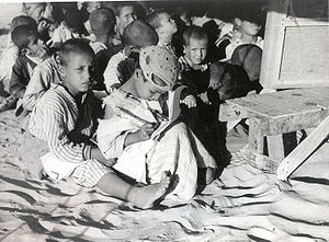 children boy and sister in makeshift School fo...