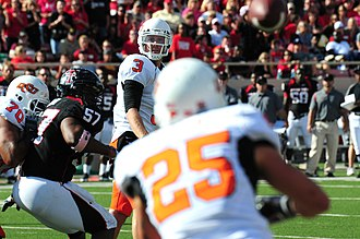 Oklahoma State–Texas Tech football rivalry - Quarterback Brandon Weeden passes to Josh Cooper in the 2010 game.