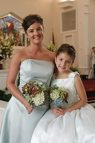 Bridesmaid - This junior bridesmaid, in North Carolina, USA, is dressed in white, just like the bride.