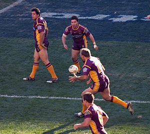 Football in Australia - An NRL match featuring the Brisbane Broncos.