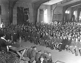 Herschel Schacter - American chaplain Rabbi Herschel Schacter conducts religious services at the liberated Buchenwald concentration camp in 1945.