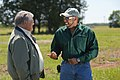 Buddy Alders, left, visits with Floyd Nauls, NRCS district conservationist, about biomethane energy production on Alders' farm. (24993954282).jpg