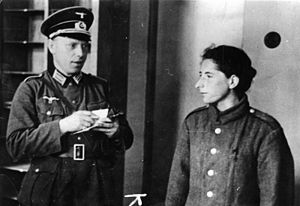German officer in M36 uniform interrogating Polish resistance fighter - World War II German uniform