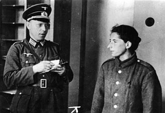 Wehrmacht uniforms - German officer in M36 uniform interrogating Polish resistance fighter