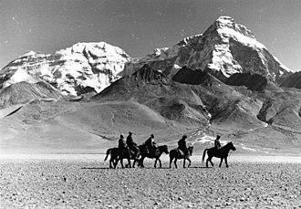 Lhasa Newar - A caravan crossing the Tuna Plain in Tibet, Mt. Chomolhari in background.