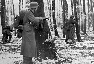 Volksgrenadier - Volksgrenadiers, equipped with StG 44, fighting in the Ardennes.