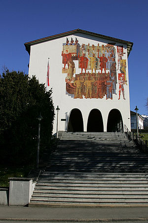 """Museum of the Swiss Charters of Confederation - The main façade of the building with the mural """"Fundamentum"""" by Heinrich Danioth"""