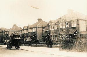 Dollis Hill - Burnley Road c. 1915 with Zeppelin flying overhead
