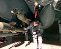 Capt. Kerry Kane performs preflight checks on precision guided munitions loaded on an F-15E.jpg