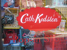 Kidston shop window display, with company logo