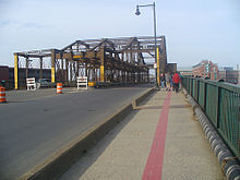 The Charlestown Bridge, looking north. The red line on the pavement is the Freedom Trail marking.