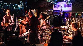 Chick Corea Elektric Band - At the Blue Note in New York City. Left to right: Eric Marienthal (saxophone), Chick Corea (keyboard), Frank Gambale (guitar), Victor Wooten (bass), Dave Weckl (drums)