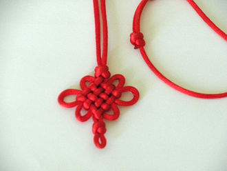 Chinese knotting - A 4-row Pan Chang knot with cross knots
