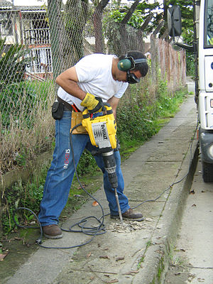 Employment - A construction worker using a jackhammer in Colombia