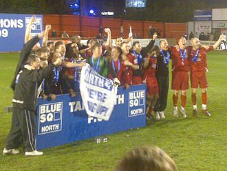 Gary Mills (footballer, born 1961) - Mills (third from right) and his Tamworth team celebrate winning the Conference North title in the 2008–09 season