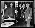 Congressional beer crusaders witness signing of beer bill. Members of Congress today witnessed the actual signing of their hard fought battle for legalized beer. Surrounding President LCCN2016870902.jpg