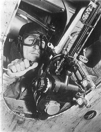 Course Setting Bomb Sight - The CSBS Mk. IX mounted in a Fairey Battle. The bomb aimer is sighting through the white ring-shaped backsights to the pin shaped foresights (just visible against the armoured cable) and holding the bomb release switch in his right hand.