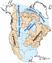 Diagram of a tan colored North America, with blue coloring in the middle of the continent representing an ancient sea.