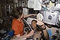Crewmembers in the spacelab with the Lower Body Negative Pressure Study 2.jpg