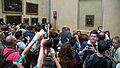 Crowd looking at the Mona Lisa at the Louvre.jpg