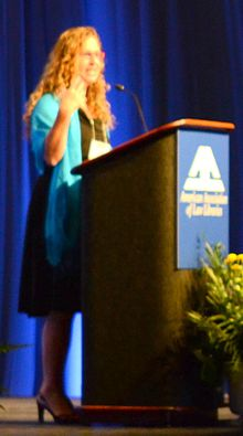 Dahlia Lithwick giving the keynote speech at the American Association of Law Libraries conference, cropped.