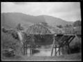 Damaged bridge over the Waipa River, 1917. ATLIB 284108.png