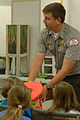Dean Austin, a park ranger with the U.S. Army Corps of Engineers Nashville district, encourages kids to properly wear a life jacket when near or in water during the 2013 Junior Gardener Camp at the Agricultural 130607-A-EO110-004.jpg