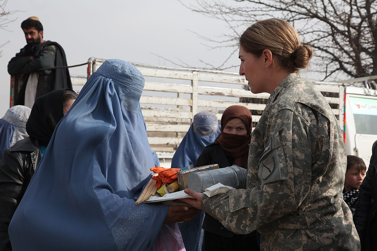 Defense.gov News Photo 110106-A-1182G-148 - U.S. Army Maj. Bobbie Mayes right the women s empowerment coordinator with the Kentucky Agribusiness Development Team gives an Afghan woman.jpg