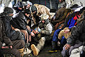 Defense.gov News Photo 120124-F-XC395-246 - U.S. Air Force Master Sgt. Chris Banks attends to injured villagers onboard a Mi-17 helicopter in Shewa village in Afghanistan s Badakhshan.jpg