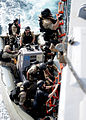 Defense.gov News Photo 120225-N-ZF681-889 - Sailors climb a ladder during visit board search and seizure team training aboard the guided-missile destroyer USS Halsey DDG 97 in the Gulf of.jpg