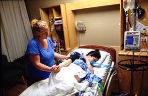Doula - A doula (left) with mother during labor