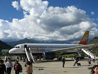 Flag of Bhutan - The flag of Bhutan figures on the livery of the national airline Druk Air.