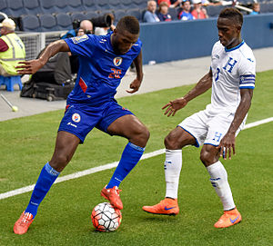 Maynor Figueroa - Duckens Nazon of Haiti against Figueroa in the Gold Cup, Sporting Park, Kansas City, Kansas, 13 July 2015.