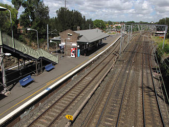 Sydney Freight Network - Dulwich Hill station looking west with the Metropolitan Goods line to Enfield in the foreground, the Rozelle branch diverging to the right