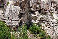 Dwellings carved into rock formations in Cappadocia.jpg