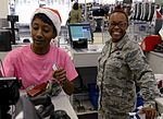 Enlisted families surprised by Random Acts of Kindness 151221-F-GR156-084.jpg