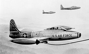 Kunsan Air Base - F-84G-25-RE Thunderjet AF Serial No. 52-3249 of the 49th Fighter-Bomber Wing being refuelled over Korea, 1953
