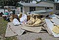 FEMA - 30608 - Debris in the front yard of a Missouri home..jpg
