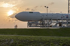 Falcon 9 rollout with TurkmenAlem52E-MonacoSAT to SLC-40 (17108097439).jpg