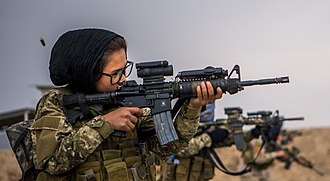 Operation Freedom's Sentinel - Female Tactical Platoon members fire during a qualification at range near Kabul, Afghanistan