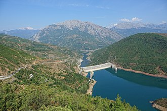 Fierzë, Tropojë - View of the Fierza dam, with Lake Koman and Fierza village behind it.