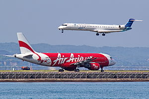 Aviation in Indonesia - Garuda Indonesia Explore and Indonesia AirAsia airplanes.