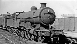 GNR Class C1 (large boiler) - No. 2825 on a stopping train at Seven Sisters, 1946