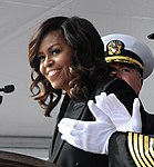 """First Lady Michelle Obama announces """"Bring the Ship to Life"""" spurring its crew members to race across the brow and fall in formation aboard USS Illinois (SSN 786) (30559596531) (cropped).jpg"""