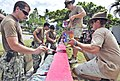 Flickr - Official U.S. Navy Imagery - A joint engineering civil action program team paint a wall outside the Beo Health Center in Talaud during a Pacific Partnership 2012 community service project..jpg