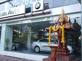 Tutelary deity - A Thai spirit house for the Jao Tee in front of an  office in Bangkok