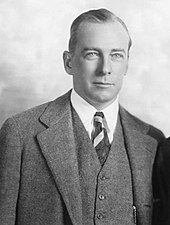 George Abbott wearing a three-piece suit