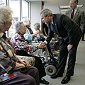 George W. Bush and Chuck Grassley greet residents at Wesley Acres Senior Center in Des Moines, Iowa.jpg